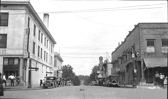 Adams St Looking North From Washington Facade Past The Western Union Sign On Left Is Entrance To Ouachita Hotel First National Bank